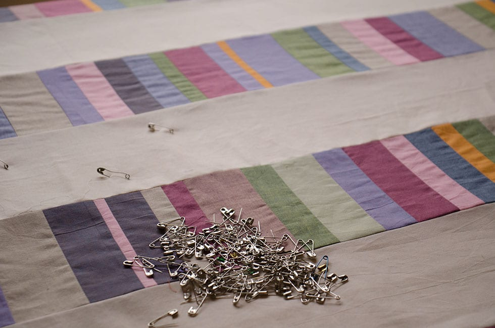 This is such a simple quilt top to make. Alternate your chinese coin strips with solid fabric