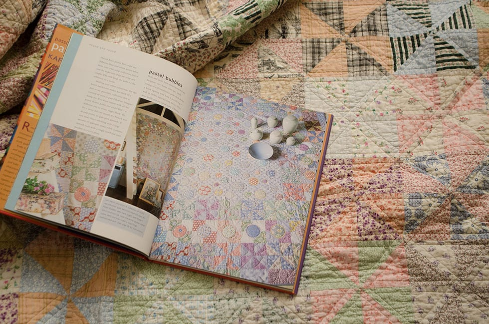 The colors in this quilt in Kaffe Fassetts book Passionate Patchwork inspired my scrappy pinwheels quilt