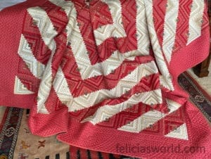 Red and cream log cabin quilt