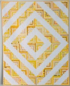 yellow and cream quilt